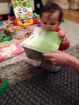 Edie enjoys re-using - book or teething toy? BOTH!